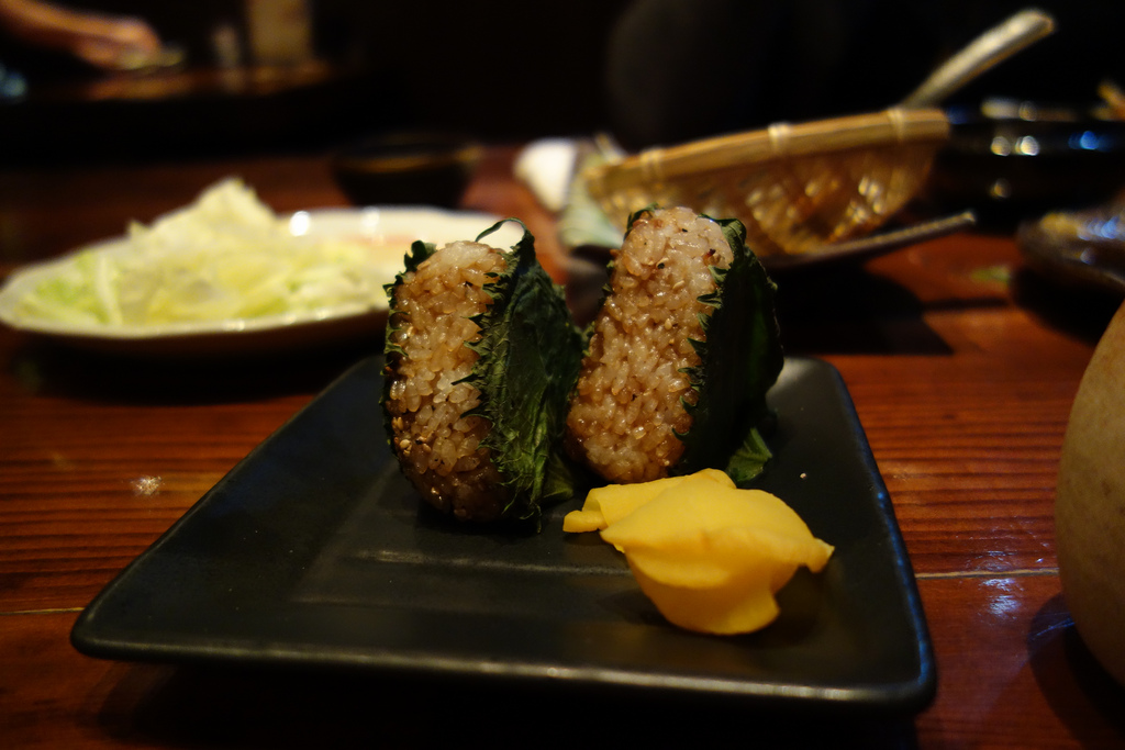 Yaki onigiri (grilled rice balls) with shiso leaf at Hatchibei ...